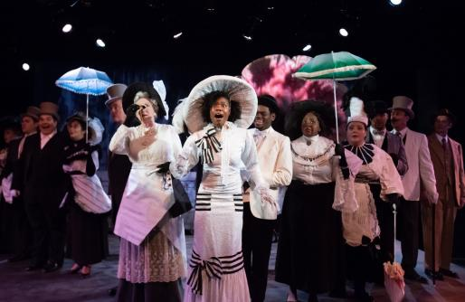 The cast of My Fair Lady, singing with umbrellas