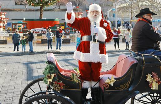 Santa standing in the carriage