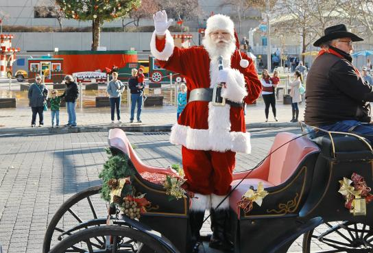 Santa standing in his carriage